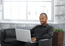 Businessman working in armchair Stock Photo