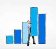 Businessman Working on a Bar Graph Royalty Free Stock Photography