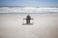 Businessman Working On Beach Royalty Free Stock Image