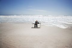 Businessman Working On Beach Royalty Free Stock Photos