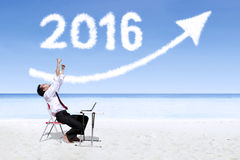 Businessman working at beach with numbers 2016 Stock Images