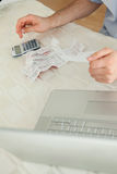 Businessman working on bills. Young businessman working on bills Royalty Free Stock Photo