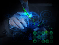 Businessman working with blue light gear to success Stock Photo