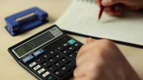 Businessman working with book and using calculator. 1920x1080 stock footage