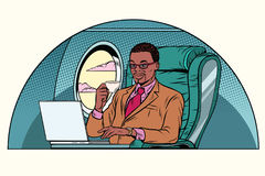 Businessman working in the business class cabin Royalty Free Stock Photo