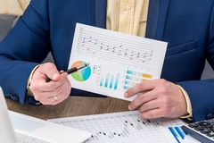 Businessman working  with business graph.  Royalty Free Stock Image