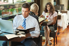 Businessman working in cafe Stock Images