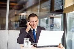 Businessman working in cafe Royalty Free Stock Image