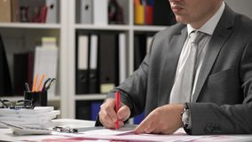 Businessman working and calculating, reads and writes reports. Office employee, table closeup. Business financial accounting conce. Pt stock footage