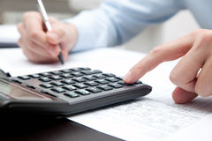 Businessman working with calculator Royalty Free Stock Image