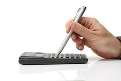 Businessman working on the calculator Royalty Free Stock Photos