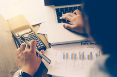 Businessman are working with a calculator and laptop. in office Royalty Free Stock Images
