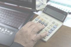 businessman working with calculator and many report royalty free stock photography