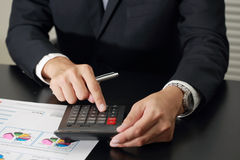 Businessman working with calculator in the meeting room Royalty Free Stock Photography