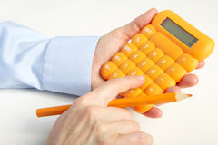 Businessman working with calculator Stock Images