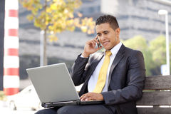Businessman working at the city park Royalty Free Stock Image