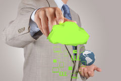 Businessman working with a Cloud Computing diagram on the new co. Mputer interface as concept stock photos