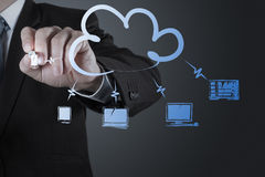 Businessman working with a Cloud Computing diagram on the new co Royalty Free Stock Images