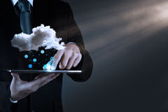 Businessman working with a Cloud Computing diagram on the new co Royalty Free Stock Photos