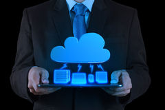 Businessman working with a Cloud Computing diagram on the new co. Businessman working with a Cloud Computing diagram on the new tablet computer interface royalty free stock photo