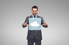 Businessman working with cloud icon projection Royalty Free Stock Images