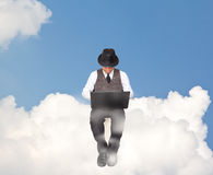 Businessman working on a cloud. Stock Photography