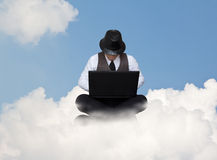 Businessman working on a cloud. Stock Image