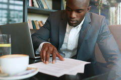 Businessman working in a coffee shop Royalty Free Stock Photography