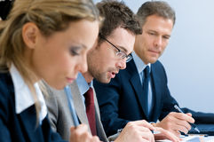 Businessman working with colleagues Royalty Free Stock Image