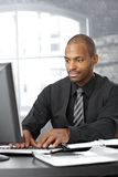 Businessman working on computer Stock Photo