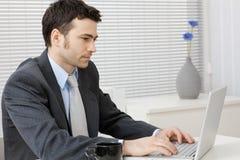 Businessman working on computer Stock Photos