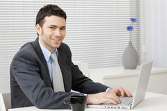 Businessman working on computer Royalty Free Stock Photos