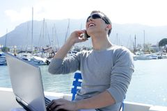 Businessman working with computer on a boat. Nice outdoor office Royalty Free Stock Images