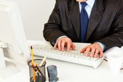 Businessman working on computer. Closeup on hands. Stock Photo