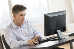 Businessman Working On Computer At Desk Stock Images