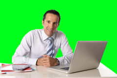 Businessman working on computer laptop sitting at office desk  chroma key. 40 to 50 years old senior businessman working on computer laptop sitting at office Royalty Free Stock Photography