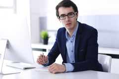 Businessman working with computer in modern office. Headshot of male entrepreneur or company manager at workplace. Business concept royalty free stock photos
