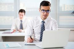 Businessman working in an office. Businessman working with computer in an office Stock Image