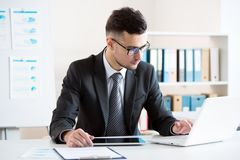 Businessman working in an office. Businessman working with computer in an office Stock Photography