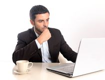 Businessman working with computer reading and thinking Royalty Free Stock Photo