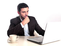 Businessman working with computer reading and thinking Stock Images