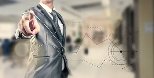Businessman working on curve line Stock Image