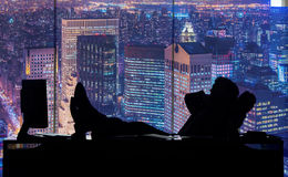 The businessman working in dark room at skyscraper Royalty Free Stock Images