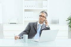 Businessman working at desk Royalty Free Stock Photography