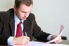 Businessman working at the desk Royalty Free Stock Images