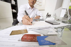 Businessman Working At Desk Royalty Free Stock Images