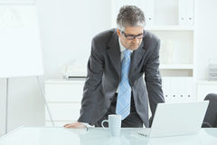 Businessman working at desk Stock Photography
