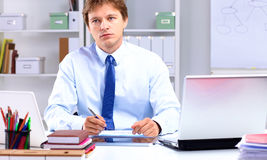Businessman working at a desk computer graphics.  Stock Photography
