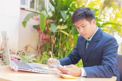 Businessman working at desk with internet wireless Stock Image