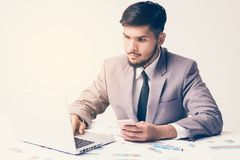 Businessman are working on the desk. With laptop and smartphone Royalty Free Stock Photo